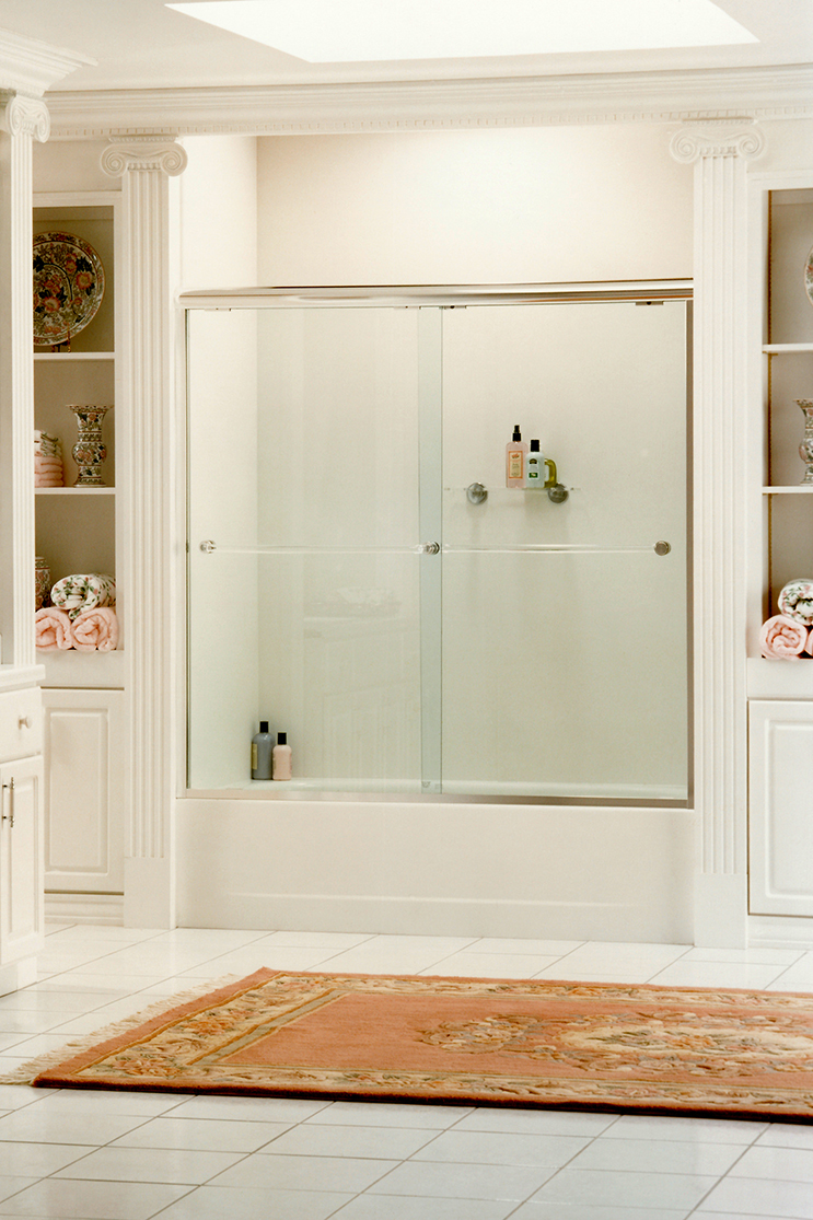 White bathroom with heavy shower doors