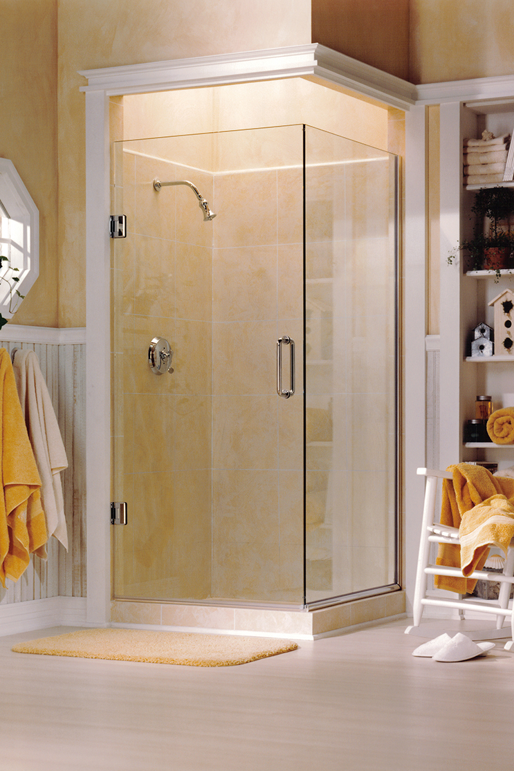 Brightly lit bathroom with heavy shower doors